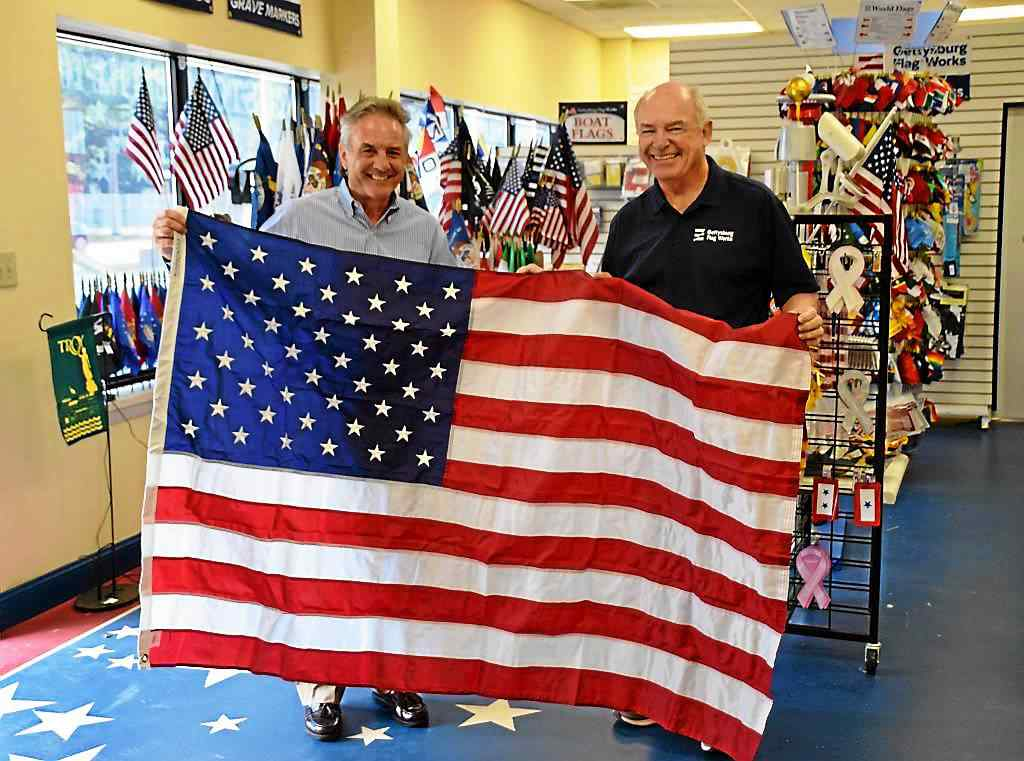 E. Greenbush flagmaker recognized for banner success