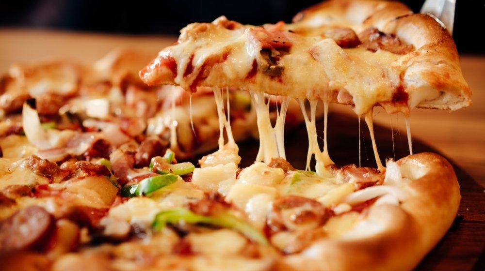 Pizza Shop Runs Unique Loyalty Program Offering Free Tattoo, Free Pizza