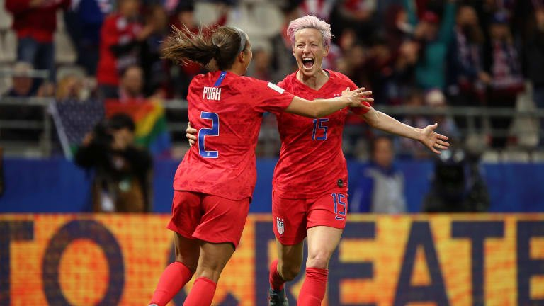 Mallory Pugh of the USA celebrates with teammate Megan Rapinoe after scoring
