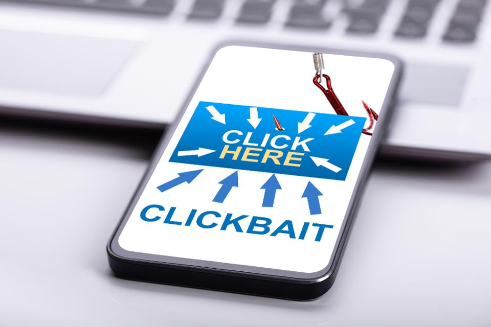 Smart Phone On Desk Highlighting Dangers of Clickbait