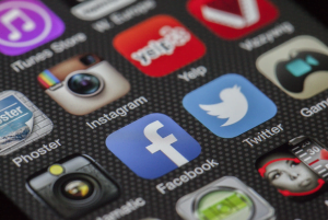 Facebook and Twitter icons together on a smartphone screen; image by LoboStudioHamburg, via Pixabay.com.