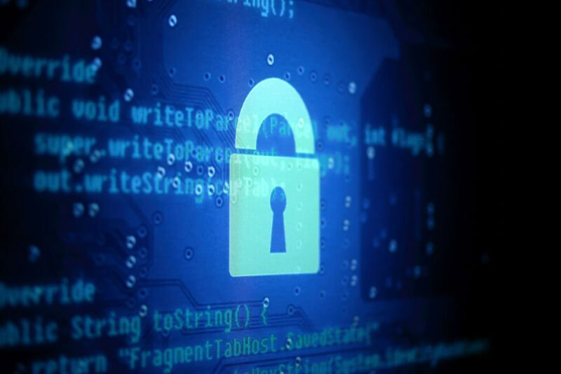 Stylized photo of a computer screen with the image of a padlock.