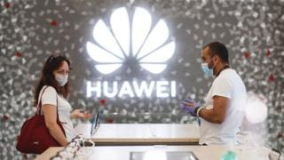 People shop at a Huawei store in Barcelona, Spain
