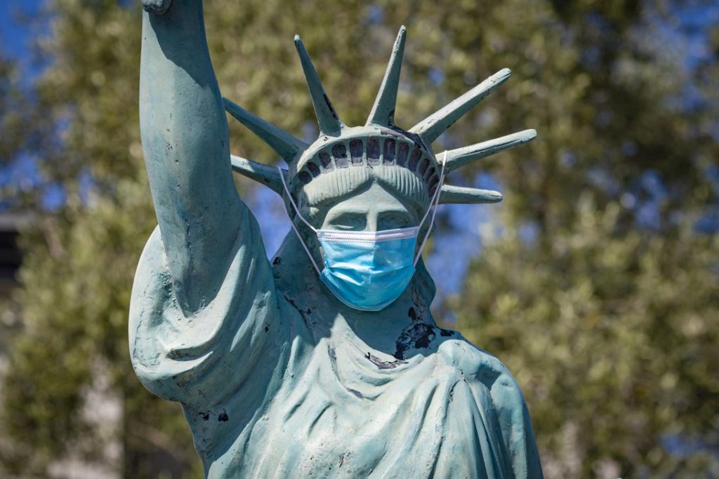 Statue of Liberty wearing a face mask to protect from Coronavirus