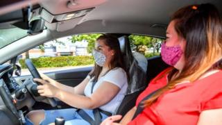 A girl in a car with driving instructor